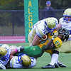 Fitchburg State Football team played Worcester State on Saturday at home. WSU players #32 Mike Goulden and #47 Adam Straughn tackle FSU player Steph'fon Teague. Adam was called for a face mask. SENTINEL & ENTERPRISE/ JOHN LOVE