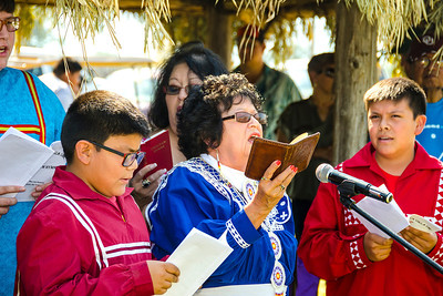 Paula Carney leads the Choctaw hymn singing in the Choctaw village.