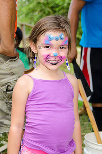Betheny Pisachubbee-Cole, 3 of Hugo, has a great time at the Labor Day Festival.