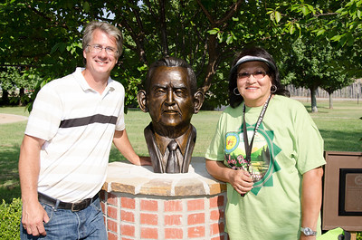John Gooden's newest sculpture for the Choctaw Nation is unveiled – the late Charley Jones, a Choctaw historian, language teacher and Councilman. Gooden is pictured with Sue Folsom, executive director of Choctaw Nation Cultural Services.