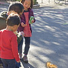 Children feeding squirrel, Berkeley campus