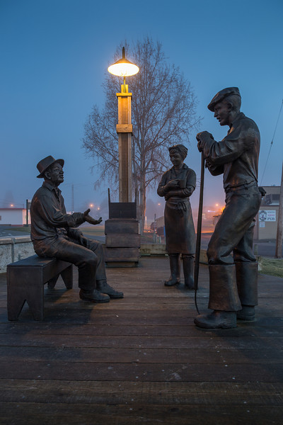 Steveston's Legacy sculpture in front of the Gulf of Georgia Cannery in Steveston on a foggy morning.