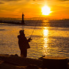 Silhouette of a fisherman at sunrise in Garry Point Park.