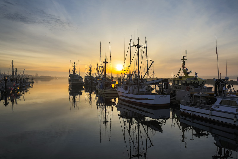 Misty sunrise at Steveston Harbour in Richmond, British Columbia, Canada.