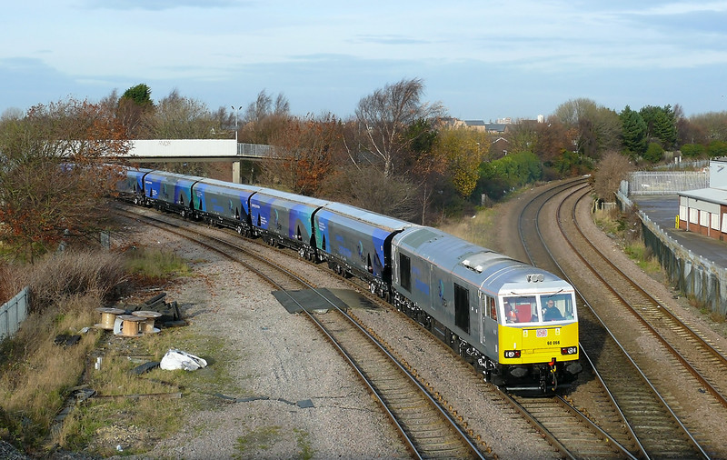 They Don't come much cleaner than this! The last 60 to be overhauled at Toton TMD 60066 is seen in its new livery about to cross Hessle Road Jn Hull. The loco is working 6H25 0950 Hull Bio Mass Terminal - Drax Power Station Bio Mass train with 11 new IIA wagons in tow. This working was run to celebrate the official opening of the Bio Mass Rapid loader on Hull Docks.
