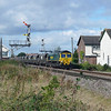 66539 is seen rushing through the small Hamlet at Welton near Brough East Yorkshire the train is 4D52 1035 York Holgate  Siding's - Hull Coal Terminal. (16092013)