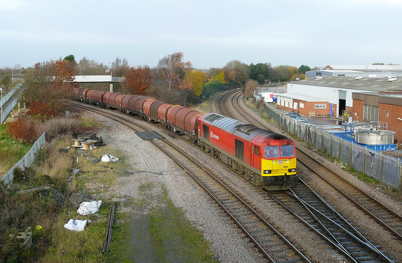 60092 is seen slowly getting into its stride and is crossing Hessle Road Jn. From this point the line starts to climb towards Bridge 5a at Dairycoates this climbe should not be an issue for the class 60 and 11,000 tons of steel coils loaded in BYA covered coil carrying wagons.