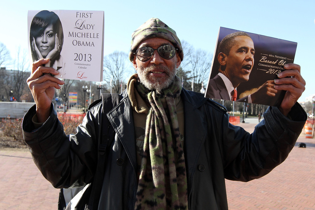 Leon Tildon, a Washington DC resident sells President and first Lady calendars on Sunday January 20 outside of Union Station the day before Obama is inaugurated for the second and final time. (Michael Cummo/ BU News)