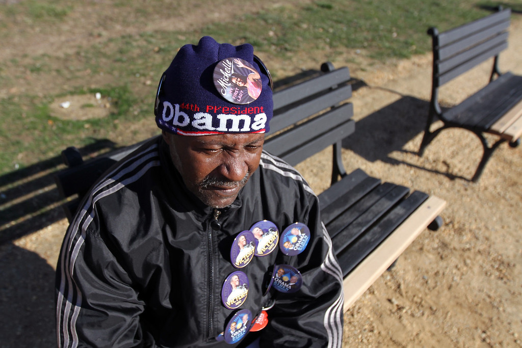 A Washington DC resident wears and sells unofficial President Obama memorabilia on Sunday January 20 the day before Obama is inaugurated for the second and final time. (Michael Cummo/ BU News)
