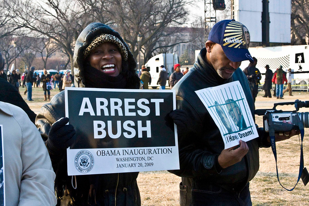 January 19, 2009 - Spectators hold signs on the National Mall in Washington, D.C. the day before the Inauguration of President Barack Obama. Photo by Billie Weiss.