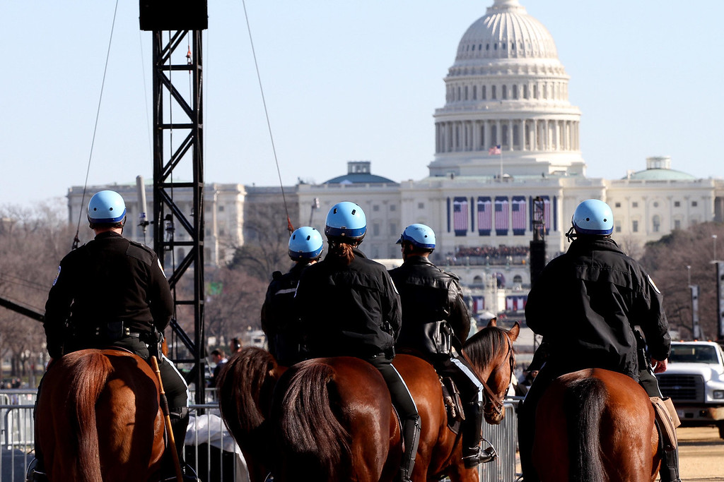 January 20, 2012 - Members of the DC Police Horse Mounted Unit patrol the National Mall in Washington, D.C. on the day before the 57th Presidential Inauguration. Photo by Billie Weiss.