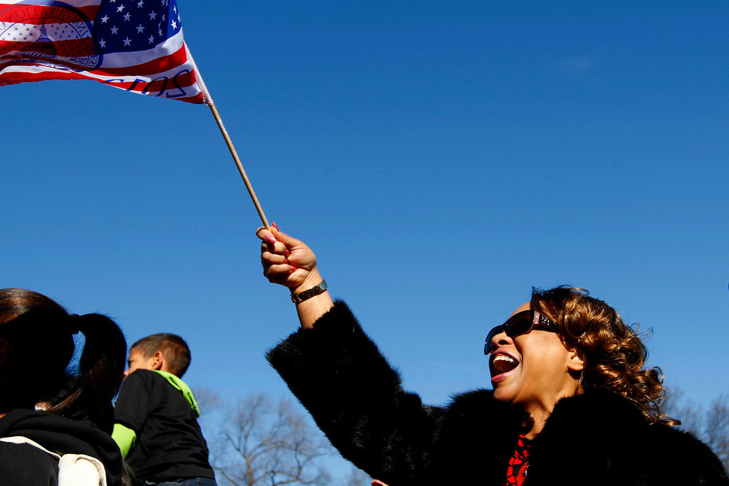 January 20, 2012 - A Barack Obama supporter reacts in front of the CNN news set on the National Mall in Washington, D.C. as she watches a telecast of the swearing-in on the day before the 57th Presidential Inauguration. Photo by Billie Weiss.