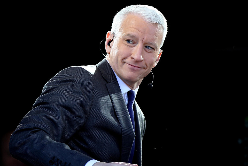 January 20, 2012 - Anderson Cooper, anchor of CNN's AC360, acknowledges spectators from atop the CNN press riser on the National Mall in Washington, D.C. on the day before the 57th Presidential Inauguration. Photo by Billie Weiss.