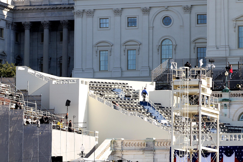 January 20, 2012 - Press risers are prepared on the West Front of the Capitol building in Washington, D.C. during the day before the 57th Presidential Inauguration. Photo by Billie Weiss.
