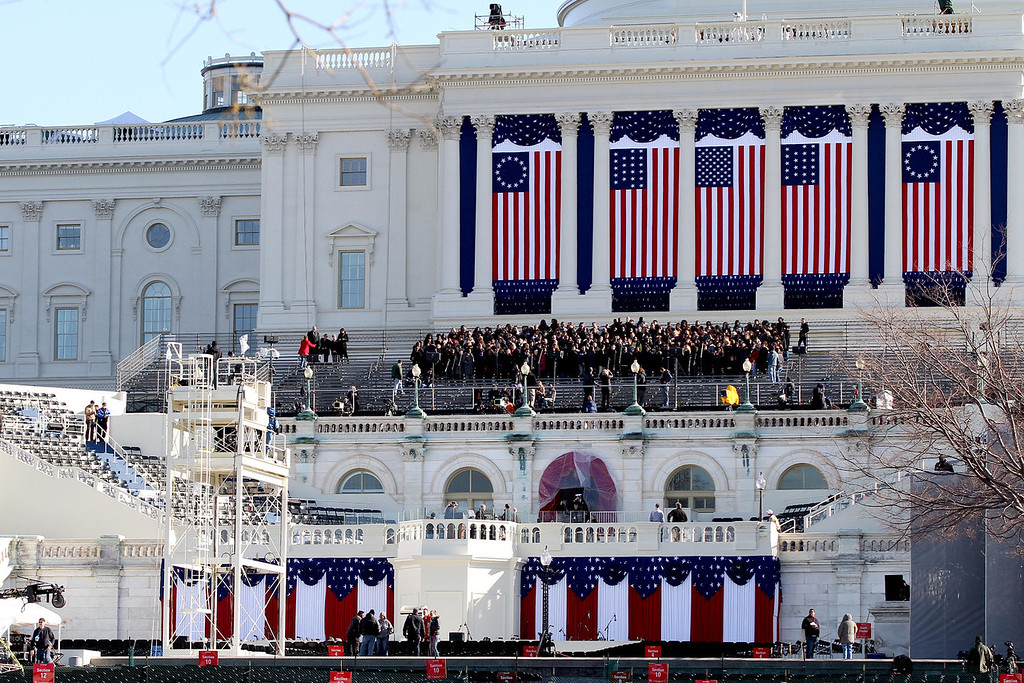 January 20, 2012 - Set up continues as the Christian University Choir rehearses on the West Front of the Capitol building in Washington, D.C. during the day before the 57th Presidential Inauguration. Photo by Billie Weiss.