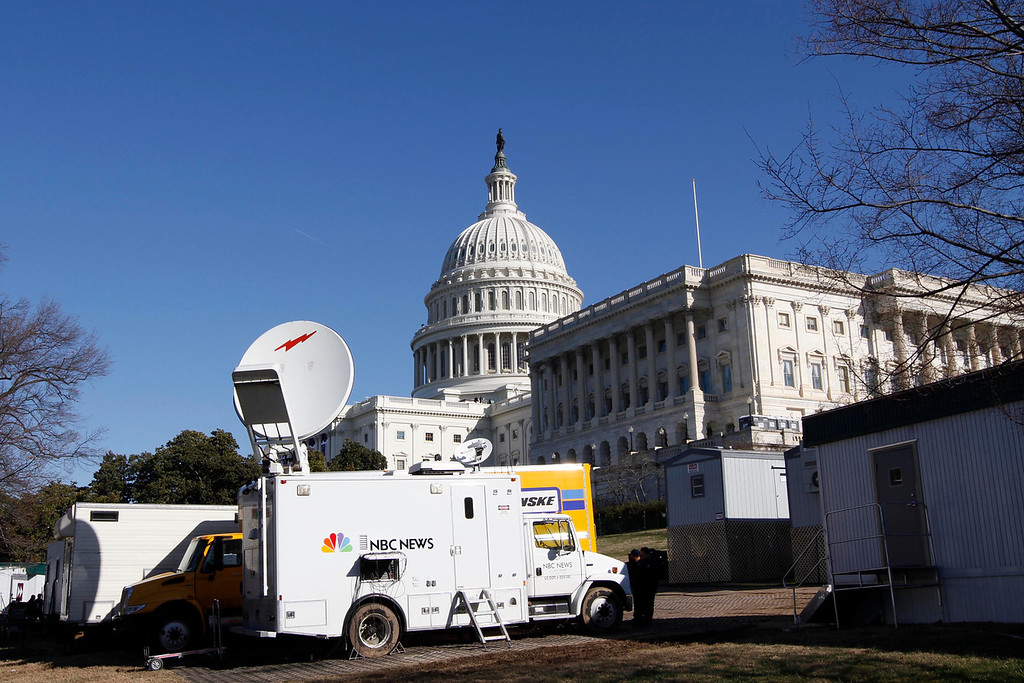 January 20, 2012 - News trucks gather near the West Front of the Capitol building in Washington, D.C. on the day before the 57th Presidential Inauguration. Photo by Billie Weiss.