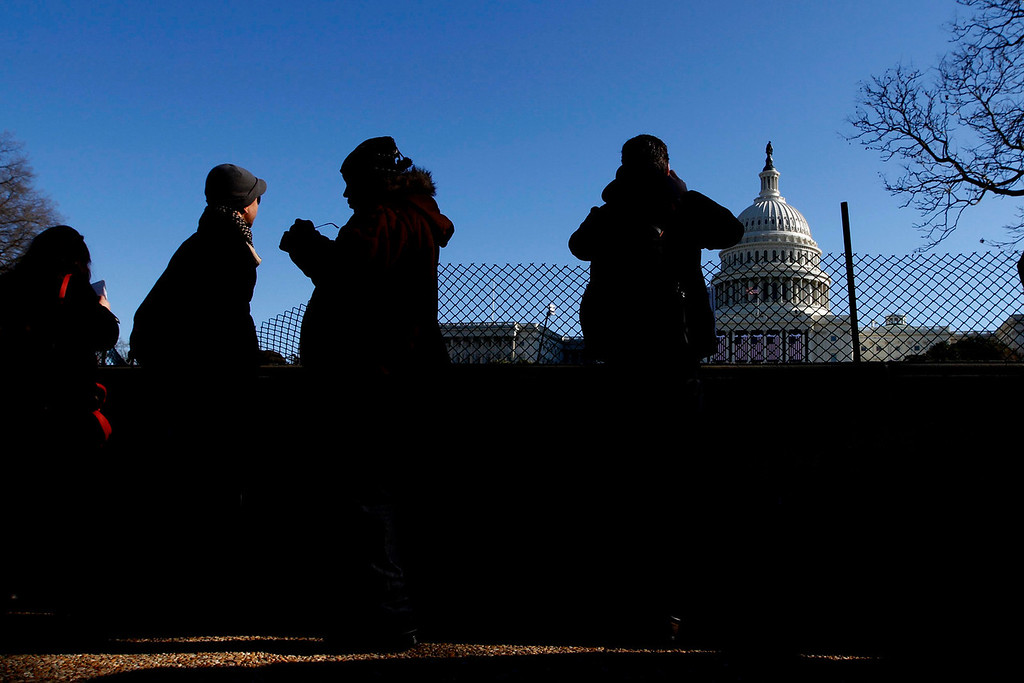 January 20, 2012 - Spectators gather near the West Front of the Capitol building in Washington, D.C. on the day before the 57th Presidential Inauguration. Photo by Billie Weiss.