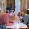 Tex Weaver helps a student read a map