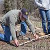 Bill Henry measures tracks.