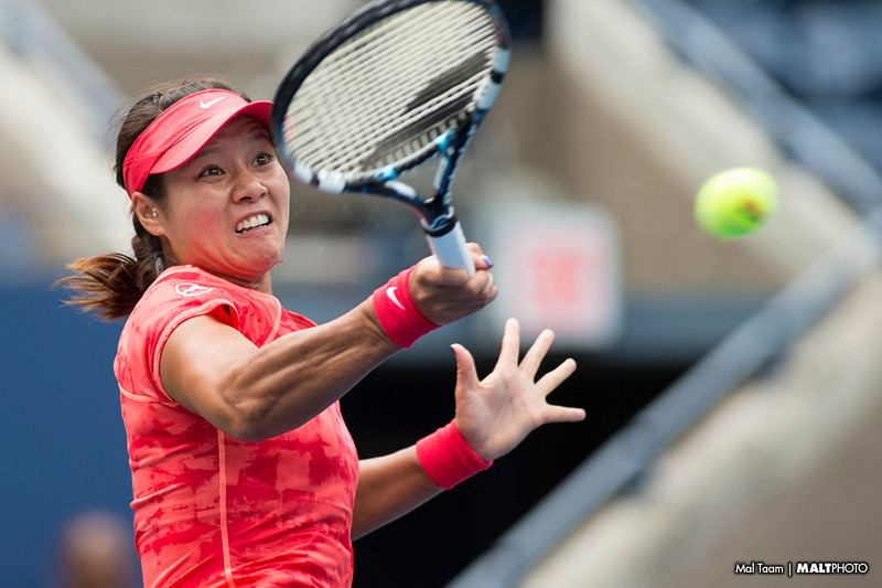 Li Na hits a forehand during her opening round match at the 2013 US Open