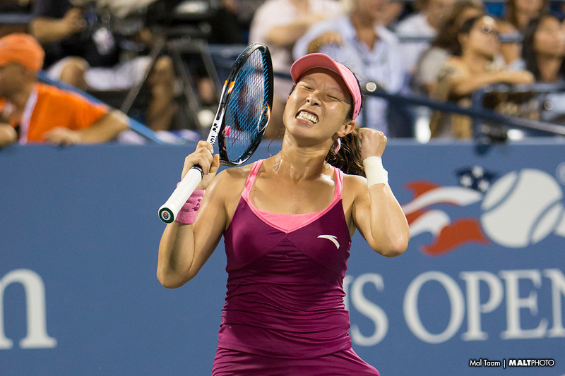 Jie Zheng celebrates after her upset win over Venus Williams in her 2nd round match.