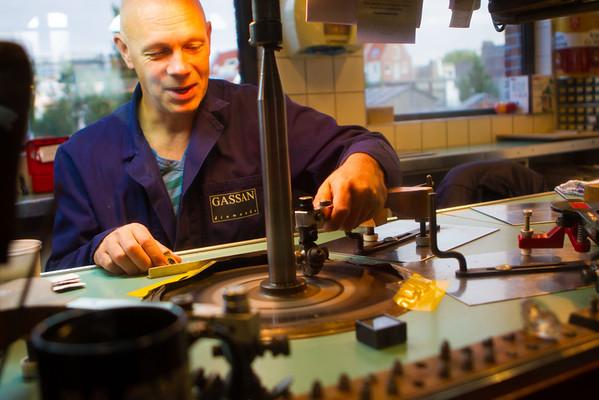 Bald guy grinding a diamond.