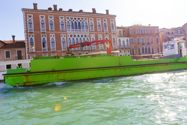 Didn't expect to see a barge to ruin the pretty gondolas and ships on the canal, but somebody's gotta do the dirty work.