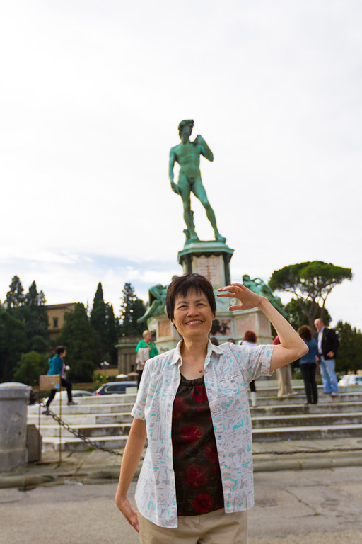 One of the many copies of the David statue. My mom trying to imitate his pose.