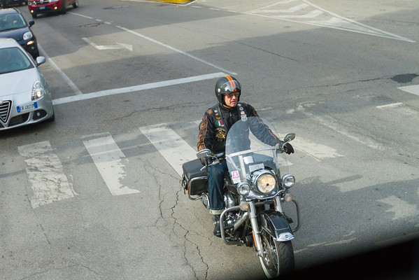 Dude riding a Harley. With Route 66 patches on his vest. In Italy.