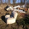 1/5/2013: Large truckload of furniture dumped on the north side of the gravel road (accessible via Hammonds Ferry Rd). West of MD295 and east of the triangle pond.  Recliner sofa/chair, 6 padded dining room chairs, glass table top shattered into pieces, various folding tables, 4 bifold closet doors, kitchen table (wood), recliner chair, Queen box spring, coffee table, lots of yard waste, and a hydrogen tank (blue). See next photo for pile ready to be picked up. UPDATE: Area cleaned on Saturday, April 6th as a part of Project Clean Stream.