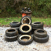 10/12/2013: Finally -- the pile ready for pickup on Race Road in HoCo - part of the Deep Run watershed. 1 tractor trailer tire, 8 light truck tires, and 7 auto tires, traffic barrel full of bottles n cans, three boots