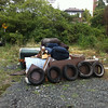 10/12/2013: Two sofas, two sofa beds, two chairs, particleboard desk pieces, four railroad ties, five tires and lots more little stuff,  Halethorpe Farms Rd near Herbert Run, Baltimore County. Approximately 1000 lbs total.