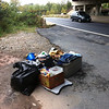 10/11/2013: Same junk, piled up neatly and under the overpass to prevent it from getting rained on further. Route 1 in Balto Co.