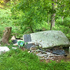 5/29/2013: From the top of the lane where dumping vehicles turn around. Most of the junk is down this slope. Mattress and box spring were dragged down the hill to the entrance of the lane to help block the way.