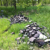 5/10/2013: Old asphalt chunks dumped along the access road could be used for berm-building.