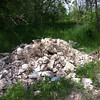 5/10/2013: Previously dumped rubble that should be used for new berms.