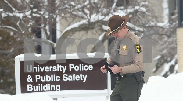 Kyle Bursaw — kbursaw@shawmedia.com<br /> <br /> A member of the Illinois State Police exits the University Police and Public Safety building at Northern Illinois University in DeKalb, Ill. on Wednesday, March 6, 2013. The FBI and Illinois State Police served a search warrant at the building.