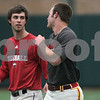 Kyle Bursaw – kbursaw@shawmedia.com<br /> <br /> Northern Illinois University baseball player Brian Sisler chats up a teammate between drills during practice at the DeKalb Recreation Center on Wednesday, March 6, 2013.