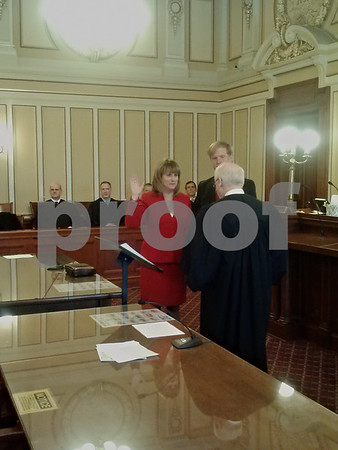 Jeff Engelhardt - jengelhardt@shawmedia.com<br /> Christine Johnson stands next to her husband Jim as she is sworn into the DeKalb County treasurer's office Monday by Judge Bill Brady.