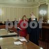 Jeff Engelhardt - jengelhardt@shawmedia.com<br /> Christine Johnson stands next to her husband Jim as she is sworn into the DeKalb County treasurer's office Monday by Judge Bill Brady.