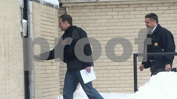 Kyle Bursaw — kbursaw@shawmedia.com<br /> <br /> FBI and Illinois State Police enter the University Police and Public Safety building at Northern Illinois University in DeKalb, Ill. on Wednesday, March 6, 2013.