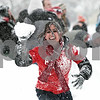 Rob Winner – rwinner@shawmedia.com<br /> <br /> Northern Illinois senior Stephanie Bourgeois prepares to throw a snowball outside University Plaza in DeKalb, Ill., Tuesday, March 5, 2013. Bourgeois helped organize the snowball fight between NIU students.