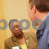 Kyle Bursaw – kbursaw@shawmedia.com<br /> <br /> District 428 school board candidate Marilyn Parker listens to a man while meeting people before the start of the candidates night forum at the Egyptian Theatre in DeKalb, Ill. on Thursday, March 7, 2013.