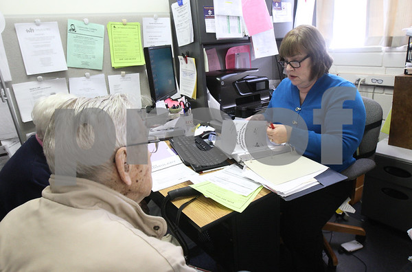 Kyle Bursaw – kbursaw@shawmedia.com<br /> <br /> Debbie Beranek (right), an information & assistance specialist for the Elder Care Services in DeKalb, helps Herbert and Laverne Selman make sense of their medical bills on Wednesday, Feb. 27, 2013.