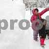 Kyle Bursaw – kbursaw@shawmedia.com<br /> <br /> Alisha Prothero, 7, tosses a snowball over her sister Zoey, 3, while playing near their giant snow fort with her dad his friends in DeKalb, Ill. on Tuesday, March 5, 2013.