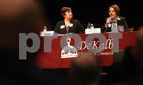 Kyle Bursaw – kbursaw@shawmedia.com<br /> <br /> District 428 school board candidate Mary Hess (right) takes her turn to gave a two-minute statement following Vickie Hernan-Faivre (left) during the candidates night forum at the Egyptian Theatre in DeKalb, Ill. on Thursday, March 7, 2013.