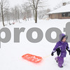 Kyle Bursaw – kbursaw@shawmedia.com<br /> <br /> Rebecca Duda, 7, pulls her sled up a slope at Hopkins Park in DeKalb, Ill. on Tuesday, March 5, 2013.