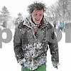 Rob Winner – rwinner@shawmedia.com<br /> <br /> After attacking an opposing team during a snowball fight, Tommy Hurrell heads back to his team's line to regroup outside University Plaza in DeKalb, Ill., Tuesday, March 5, 2013.