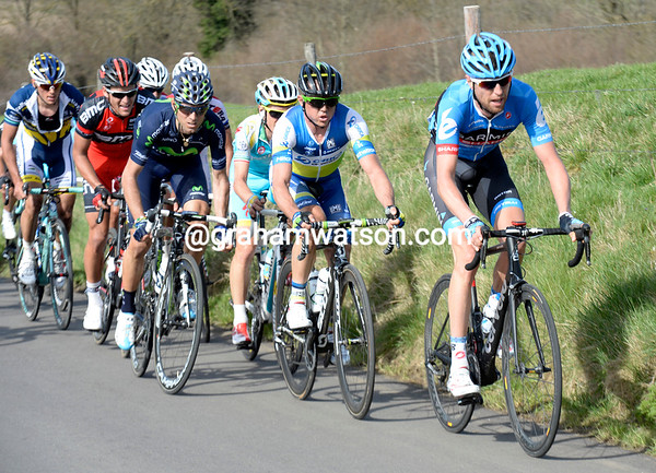 Ryder Hesjedal leads Simon Gerrans at the head of the peloton as they climb the Keuteberg...