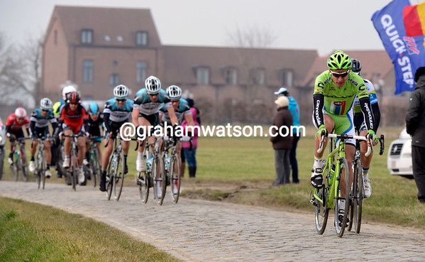 Sagan is the nearest chaser of Cancellara on the windswept Kwaremont plateau...